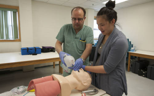 Nain participant Chaim Andersen learns about resuscitation from Barry Trenchard, MUN Medical Technologist